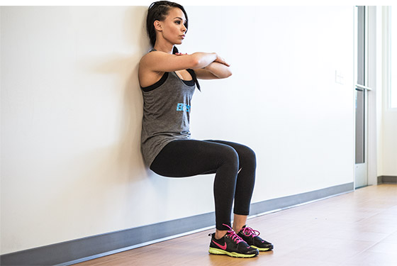 woman doing a wall sit