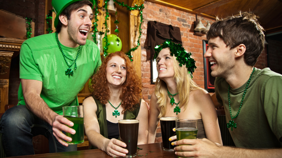 friends enjoying the bar and dressed in saint patricks day attire