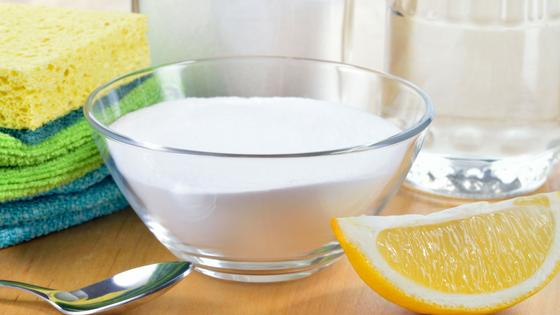 bowl of baking soda and a lemon wedge
