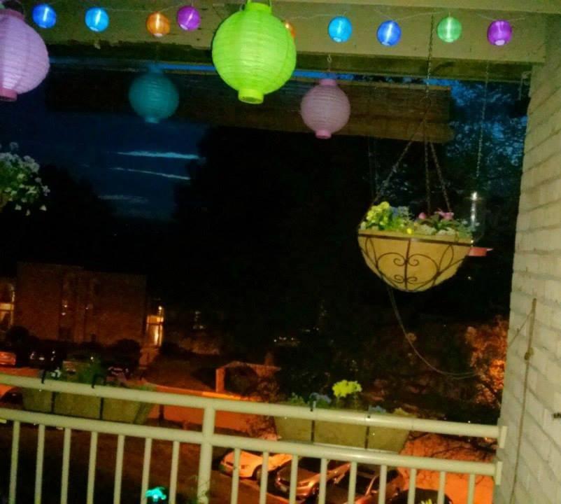 nightime balcony with lantern lights